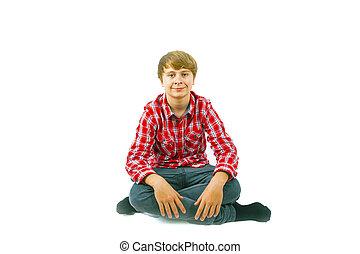 smart boy sitting on the floor