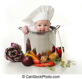 Portrait of a baby sitting wearing a chef hat sitting inside and licking a large cooking stock pot surrounded by vegetables and food, isolated on white