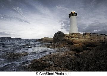 lighthouse seen from a tiny beach in Sardinia.