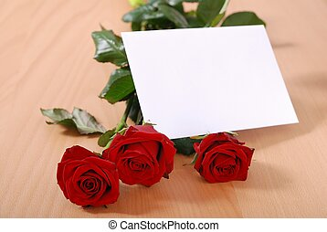 Love message on table - red roses with envelope