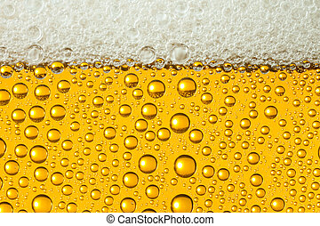Close-up of sweaty glasses of beer with drops of water