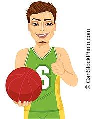 male basketball player holding ball