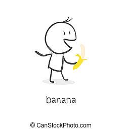 Man eats a banana.
