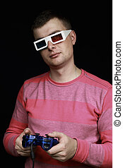 Man in the 3d glasses with a joystick in their hands