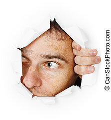 The man startled looks through a hole