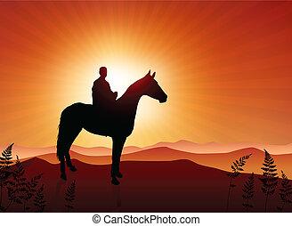 man on horse sunset background