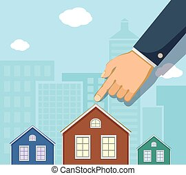 Man points a finger at the house. Buying a property