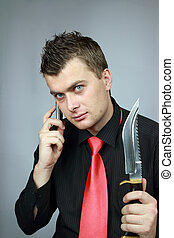 man speaks by phone