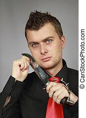 man struggles a knife