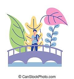 man walking in the bridge nature plants