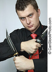 man with two knifes in hands