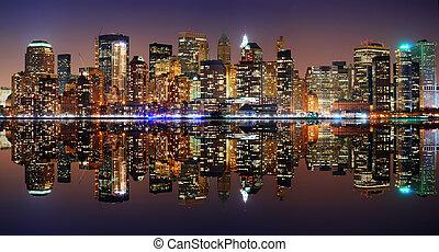Manhattan panorama, New York City Skyline at night with reflection