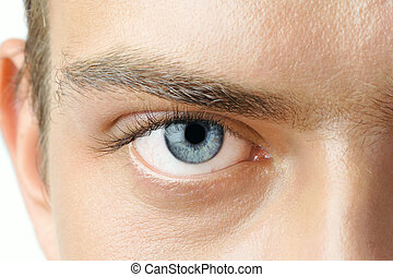 Macro shot of man's blue eye with visible blood vessels