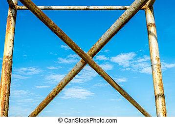 metal cross against the blue sky