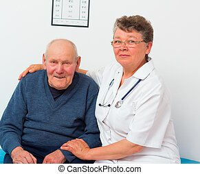 Middle-Aged Doctor With Elderly Patient
