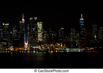 The skyline of midtown Manhattan, New York at night as seen from Weehawken, New Jersey