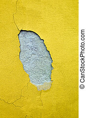 on the facade of a house is because of moisture from the paint.