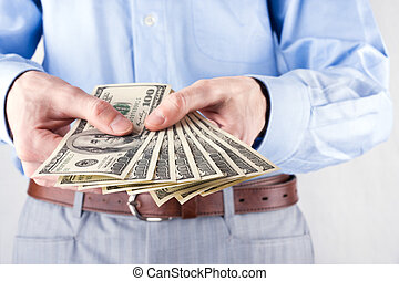 Money in the hands of the businessman