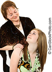 Beautiful mother daughter portrait over white.