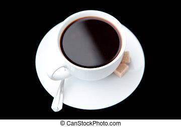 Mug of black coffee against a black background