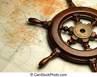 helm and nautical map, useful for various navigation or travel themes