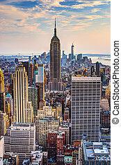 New York City, USA midtown skyline at dusk.