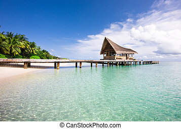 Nice scenery over beach with the water villas, Maldives