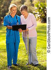 nurse showing senior patient medical test results