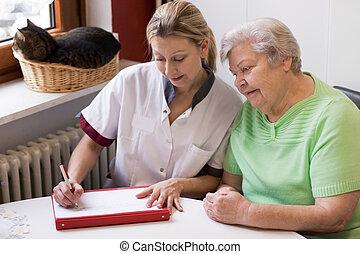 nurse visiting a patient at home
