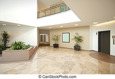 Entrance hall of business office in beige and white with marble fooor