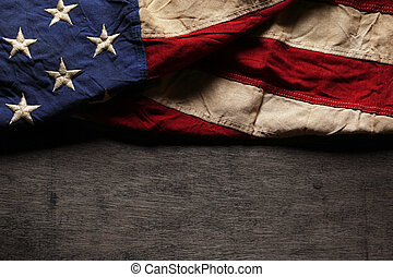 Old and worn American flag for Memorial Day or 4th of July