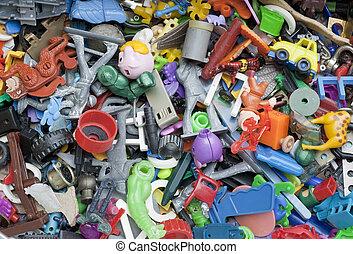 Old forgotten broken little toys background