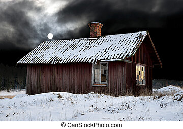 Old shack in winter evening