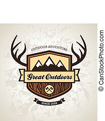 Wood themed outdoors emblem with mountains and antlers