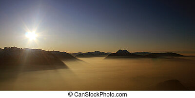 panorama of mountains in the alps at sunset