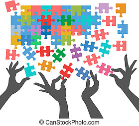 Female hands work together to connect jigsaw puzzle pieces