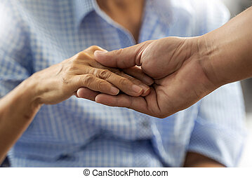 People old woman and young hand care holding healthcare disabled walking with assistance.