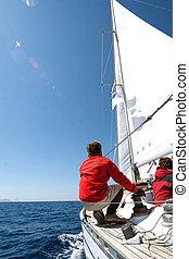 People on sailing boat on the sea