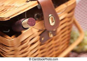 Picnic Basket, Wine Bottle and Empty Glasses