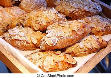 almond croissant bread on buffet line