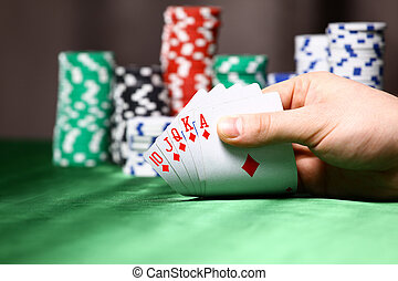 Place a poker player. chips and card