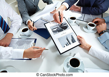 Image of human hands during discussion of business plan
