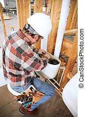 Plumber Installs Toilet