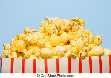 A big over stuffed bag of delicious popcorn.