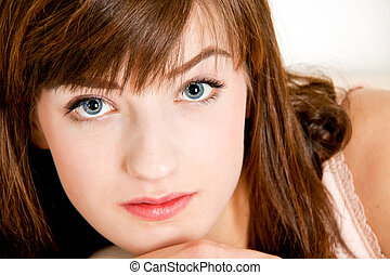 portrait of a beautiful young brunette girl with a bright smile