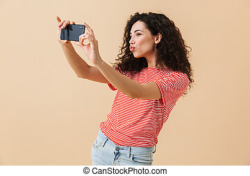 Portrait of a beautiful young girl with curly hair
