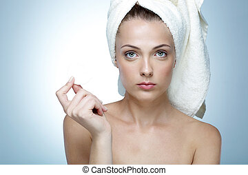 Portrait of a beautiful young woman with towel on head