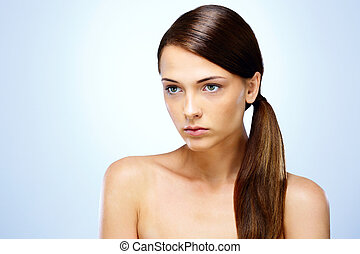 Portrait of a cute pensive young girl with fresh face