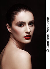 portrait of a girl on a black background with red lips