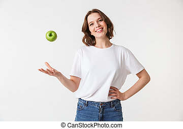 Portrait of a happy young woman with green apple